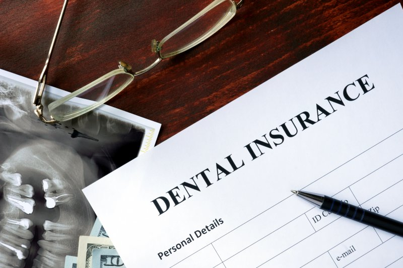 A dental insurance form sitting on a table.