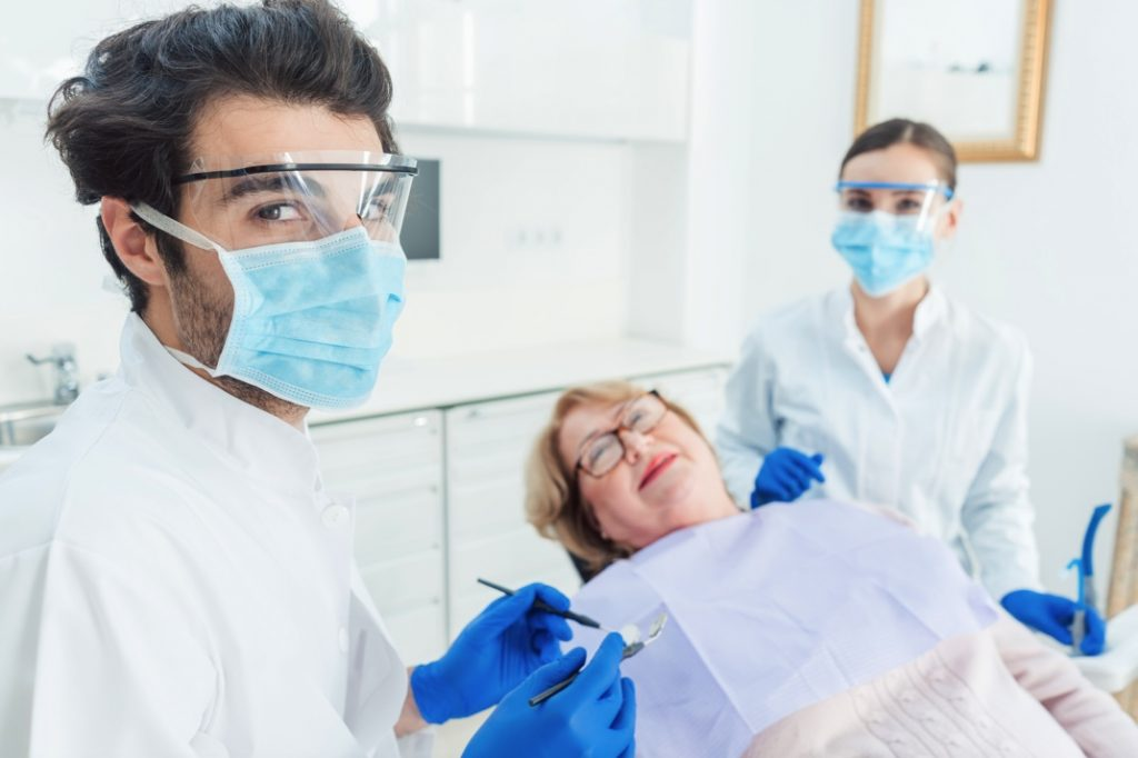 Dentists in Crookston wearing face shields during pandemic