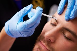 person receiving BOTOX in Crookston from a cosmetic dentist